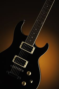 Free Black Electric Guitar On Orange Royalty Free Stock Photography - 21187307