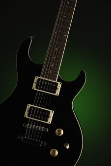 Black Electric Guitar On Green Royalty Free Stock Photo