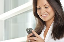 Free Businesswoman Using A Cell Phone Royalty Free Stock Photography - 21188027