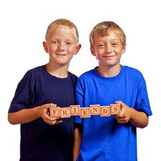 Young Friends Holding Letter Blocks Stock Photography
