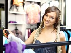 Free Young Girl Buying Clothes Royalty Free Stock Photo - 21190375