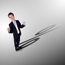 Businessman With Shadow As A Currency Symbol Royalty Free Stock Photos