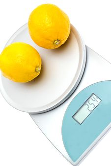 Free Lemons On The Scales Isolated Stock Photos - 21190943