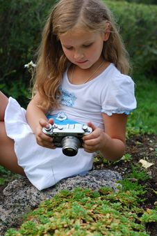 The Little Girl With The Old Camera Stock Photography