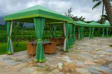Free Green Cabanas With Tables And Chairs Royalty Free Stock Photography - 21194137