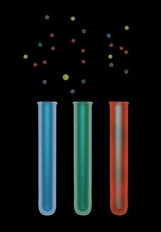 Green, Blue And Red Test Tubes On Black Stock Photos