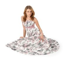 Young Woman In A Dress Sitting On Floor Stock Photos