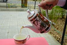 Pouring Tea In A Teacup Stock Images
