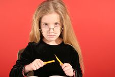 Mad Little Girl Breaking Pencil Royalty Free Stock Photos