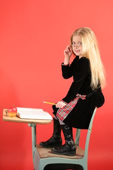 Little Girl Sitting In School Royalty Free Stock Image