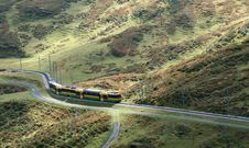 Train Winding Through Moutains Stock Photos