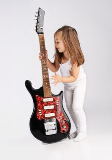 Free Small Child Hold Red Acoustic Guitar. Music Stock Photos - 21202243