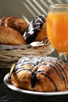 Chocolate Bread And Orange Juice Stock Photos