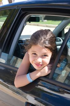 Free A Girl Looks Out The Car Window Royalty Free Stock Photo - 21202945