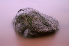 Stone In Misty Water Royalty Free Stock Photo