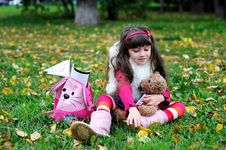 Free Cute Little Girl Wearing Fur Coat In Autumn Forest Stock Images - 21206294