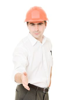 Businessman In Helmet Holds Out His Hand. Royalty Free Stock Photos