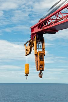 Free Crane Boom And Hook Over The Sea Stock Image - 21209081