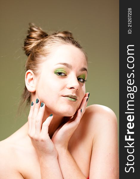 Pretty model with luxury make-up, green manicure