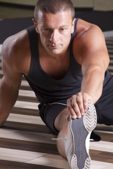 Free Fitness Instructor Streching His Leg Stock Image - 21210971