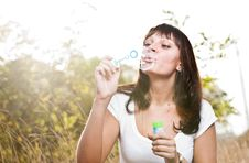 Free Young Beautiful Girl Blowing Bubbles Stock Image - 21211891
