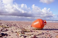 Orange Buoy On The Sea Beach Royalty Free Stock Photography