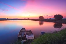 Free Sunset Along The Pond With Isolated Boats Royalty Free Stock Photo - 21217635