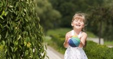 Little Girl Playing Ball In The Park Royalty Free Stock Photography