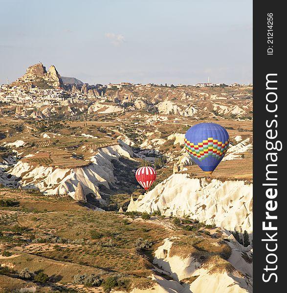 Low flying balloons ravine Uchisar Turkey