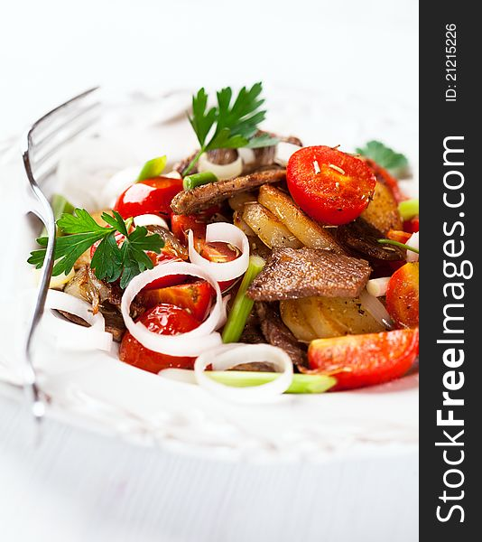 Pan-cooked potatoes with meat and onions (Tyrol)