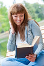 Free Young Woman Reading A Book Sitting On The Bench Royalty Free Stock Photos - 21220368