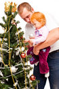 Free Dad With Daughter Decorate A New-year Tree Stock Photo - 21222400