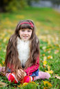 Free Cute Little Girl Wearing Fur Coat In Autumn Forest Stock Images - 21224074