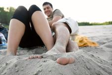Free Two Young People Sitting On The Beach Stock Photos - 21220633