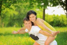 Free Young Couple Enjoying Backriding Outdoors Royalty Free Stock Photo - 21221485