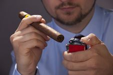 Free Hand With A Cigar And Lighter Stock Photos - 21223423
