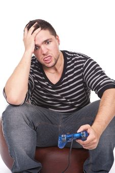 Free Young And Furious Man With A Joystick Royalty Free Stock Photography - 21223817