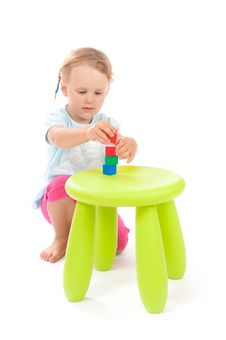 Free Little Girl Playing With Blocks On The Stool Royalty Free Stock Image - 21224566