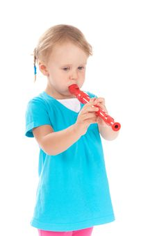 Free Child In The Studio Playing The Flute Royalty Free Stock Photo - 21224605