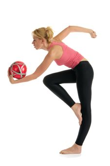 Free Woman Standing With The Ball Makes The Exercise Stock Photography - 21228082