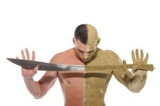 Free Young Man Half Smeared With Clay With Sword Royalty Free Stock Photos - 21228298