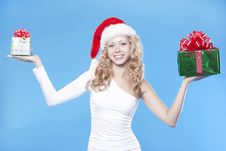 Free Pretty Santa Girl With A Present Gift For New Year Stock Photos - 21228803