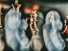 Free Business Game Competitive Strategy With Chess Board Game With Blur Background Royalty Free Stock Images - 212227409