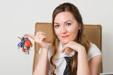 Free Beautiful Girl With The Keys In The Office Royalty Free Stock Photos - 21230828