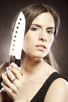 Free Beautiful Woman With A Knife Royalty Free Stock Image - 21231556