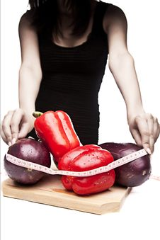 Free Woman In Black Measuring Vegetables Royalty Free Stock Photography - 21231697
