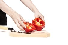 Free Woman Cutting A Pepper In Half Stock Photo - 21231730