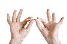 Free Man S Hands Breaking A Cigarette Royalty Free Stock Photo - 21236215