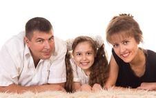 Free Cute Family On Carpet Royalty Free Stock Photos - 21236668