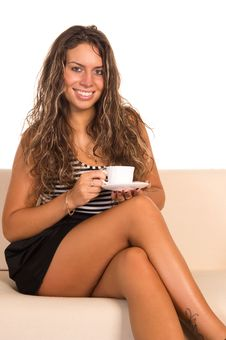 Free Girl With A Cup On  Sofa Stock Image - 21236891